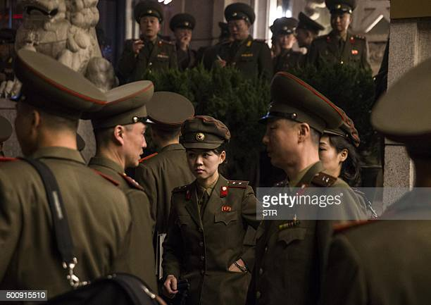 TOPSHOT This picture taken on December 10 2015 shows members of North Korea's Moranbong band talking outside the hotel they are staying at in Beijing...
