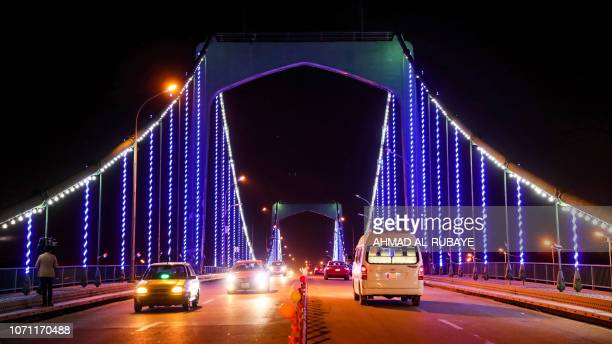 This picture taken on December 10 2018 shows cars traversing the 14th of July Bridge which links the Iraqi capital Baghdad's southern Karrada...