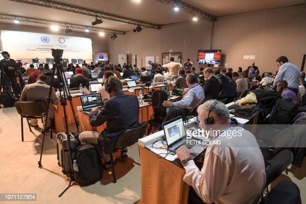 This picture taken on December 10 2018 shows journalists at work at the press centre of the United Nations Global Compact for Migration at the...