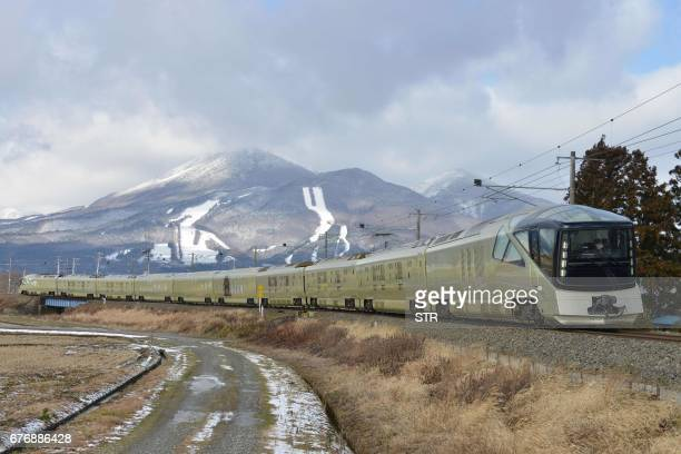 This picture taken on December 11 2016 shows the Train suite ShikiShima operated by East Japan Railway during a training run in Inawashiro Fukushima...