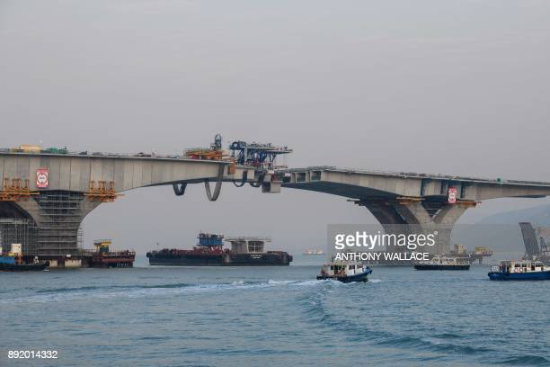 This picture taken on December 11 2017 shows a section of the Hong KongZhuhaiMacau Bridge still under construction in Hong Kong Billed as the world's...