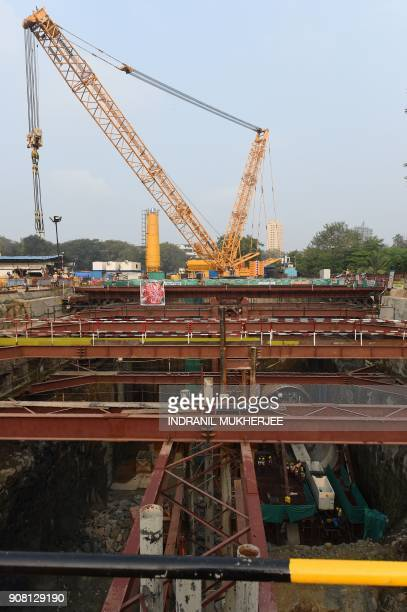 This picture taken on December 11 2017 shows workers working in the underground tunnel at a metro railway working site in Mumbai The new underground...