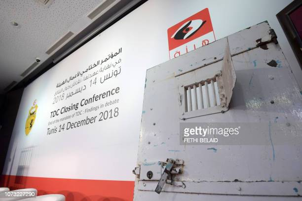 This picture taken on December 14 2018 shows an old prison gate on display by the speakers' podium at the closing conference of Tunisia's Truth and...
