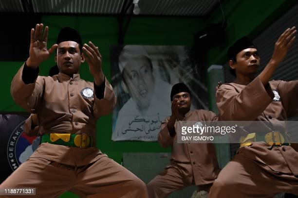 This picture taken on December 14 2019 shows pencak silat practitioners a martial art indigenous to Southeast Asia practice in Jakarta The inclusion...