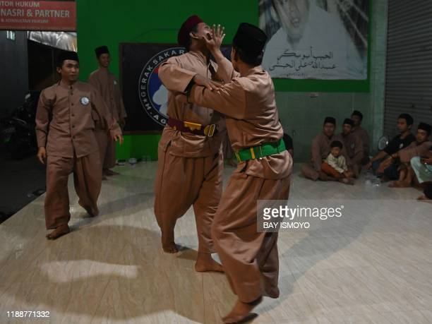This picture taken on December 14 2019 shows pencak silat practitioners a martial art indigenous to Southeast Asia sparring during practice in...