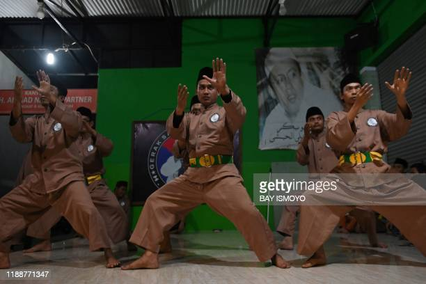 TOPSHOT This picture taken on December 14 2019 shows pencak silat practitioners a martial art indigenous to Southeast Asia taking part in a session...