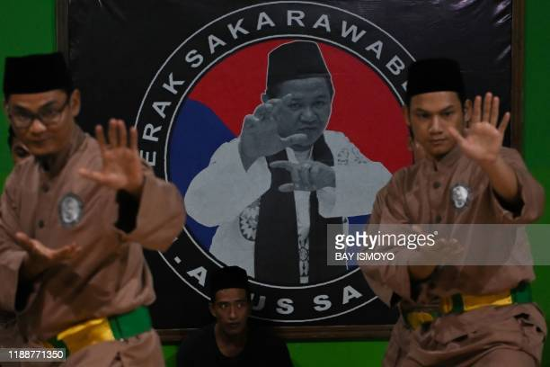 This picture taken on December 14 2019 shows pencak silat practitioners a martial art indigenous to Southeast Asia taking part in a session in...