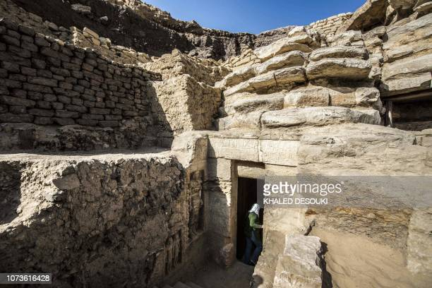 This picture taken on December 15 2018 shows a view of the entrance of a newlydiscovered tomb belonging to the high priest Wahtye who served during...