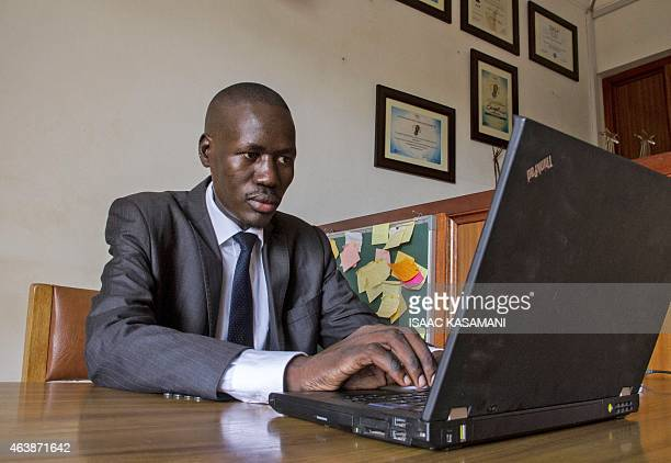 This picture taken on December 19 2014 shows Gerald Abila the Managing Director of Barefoot Lawyers at his office in Kampala When revealing...