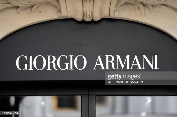 This picture taken on December 19 2017 shows a logo outside the fashion house and luxury goods Giorgio Armani shop on the Avenue Montaigne in Paris...