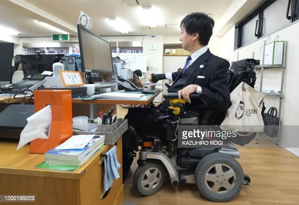 This picture taken on December 2, 2019 shows Personal Assistant Machida founder Shinya Ando, who was paralysed from the chest down after a motorbike...