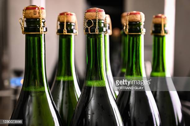 This picture taken on December 2 in Ay, near Epernay, shows bottles of the French champagne house Bollinger on a control and quality chain.