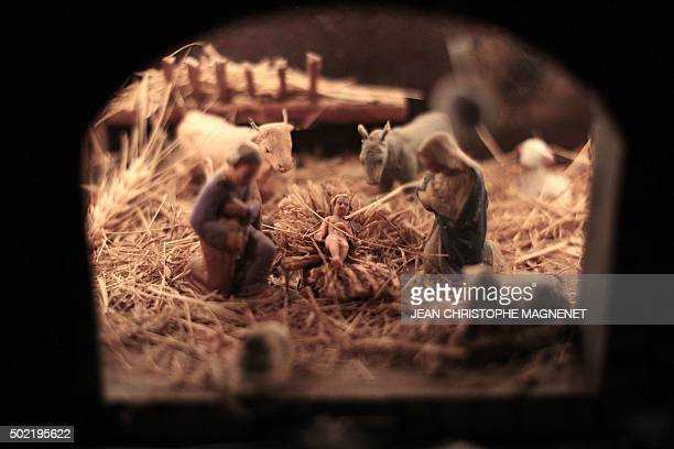 This picture taken on December 21 2015 shows a Christ's nativity scene in Luceram southeastern France on December 21 2015 / AFP / JEAN CHRISTOPHE...