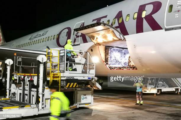 This picture taken on December 21, 2020 shows the arrival of shipments of the Pfizer-BioNTech COVID-19 coronavirus vaccine at Qatar's Hamad...