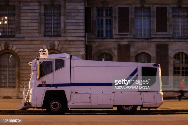 This picture taken on December 22 2018 shows a police water canon truck parked near the Chateau de Versailles in Versailles outside Paris as 'Yellow...