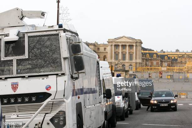 This picture taken on December 22 2018 shows a police water canon truck parked near the Chateau de Versailles in Versailles outside Paris as...