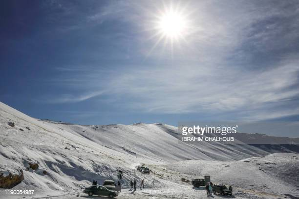 This picture taken on December 22 2019 shows a general view of the snow at an elevation of 1700 metres on the mountains in the northern Lebanese town...