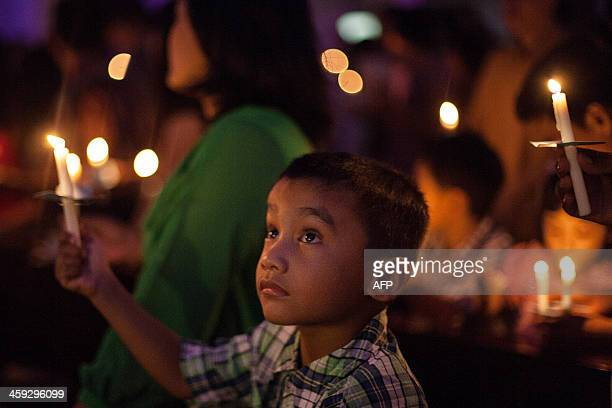 This picture taken on December 24 2013 shows Christian worshipers attending a mass prayer in Banda Aceh Indonesian Christians celebrated Christmas...