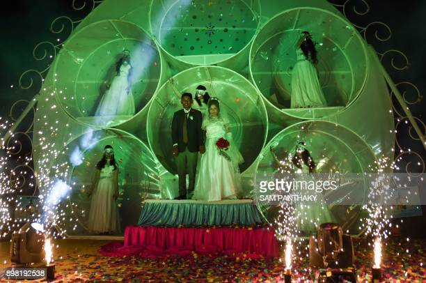 This picture taken on December 24 2017 shows an Indian Christian couple taking part in a mass wedding in Surat some 270km from Ahmedabad 251...