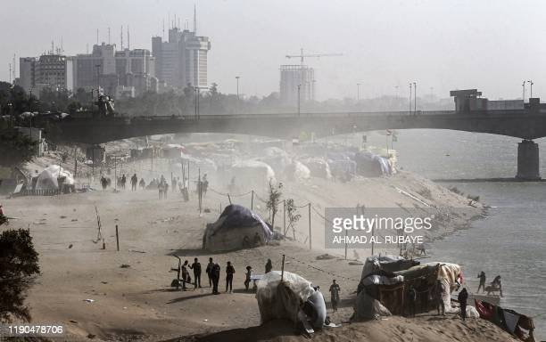 TOPSHOT This picture taken on December 25 2019 shows a view of tents in a sitin along the Tigris river near the Senak bridge erected by...