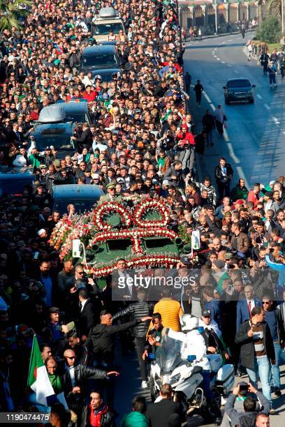 This picture taken on December 25 2019 shows a view of the funeral of Algeria's late military chief Lieutenant general Ahmed Gaid Salah in the...
