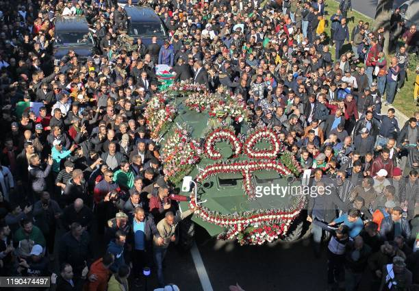TOPSHOT This picture taken on December 25 2019 shows a view of the funeral of Algeria's late military chief Lieutenant general Ahmed Gaid Salah in...