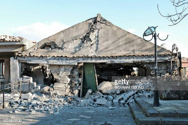 TOPSHOT This picture taken on December 26 2018 shows damaged buildings in Zafferana Etnea near Catania on December 26 after a 48magnitude earthquake...