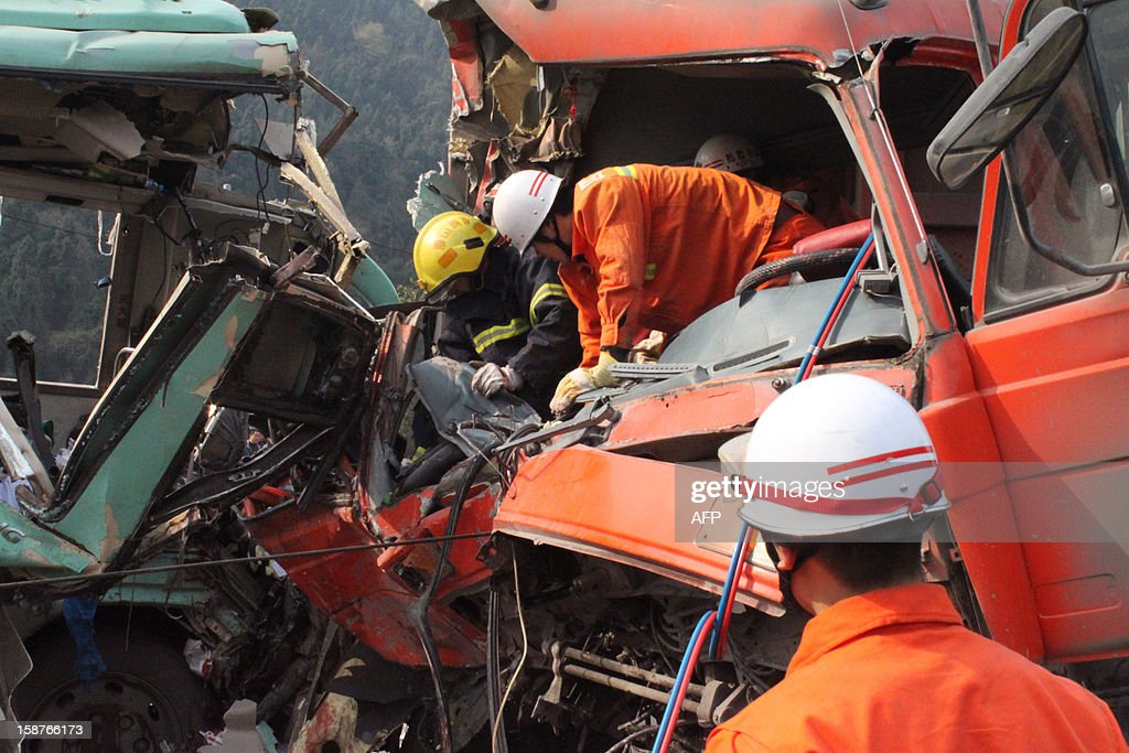 This picture taken on December 27, 2012 shows rescue workers attempting to save victims following an accident in Renshou, southwest China's Sichuan province. The accident resulted in seven dead and 19 injured. CHINA