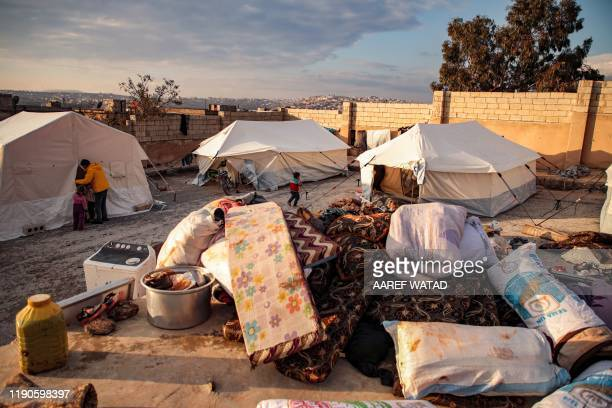 This picture taken on December 27, 2019 shows a view of supplies outside tents of displaced Syrians, who fled from government forces' advance on...
