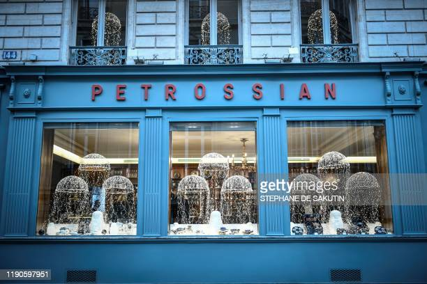 This picture taken on December 27 2019 shows the Christmas windows of the luxury food shop Petrossian in Paris