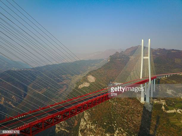 This picture taken on December 28 2016 shows the Beipanjiang Bridge near Bijie in southwest China's Guizhou province The world's highest bridge has...