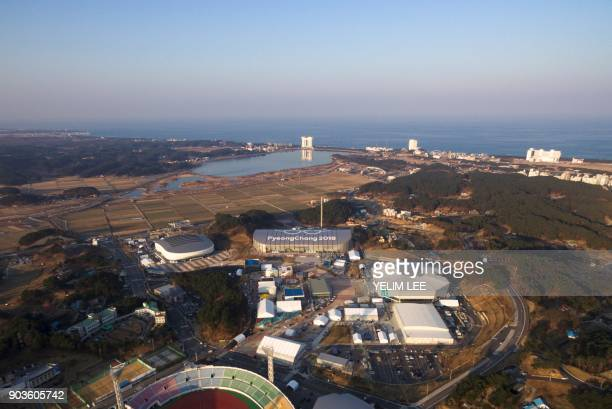 This picture taken on December 28 2017 in Gangneung shows venues for the 2018 Pyeongchang Winter Olympics including Gangneung Ice Arena Gangneung...
