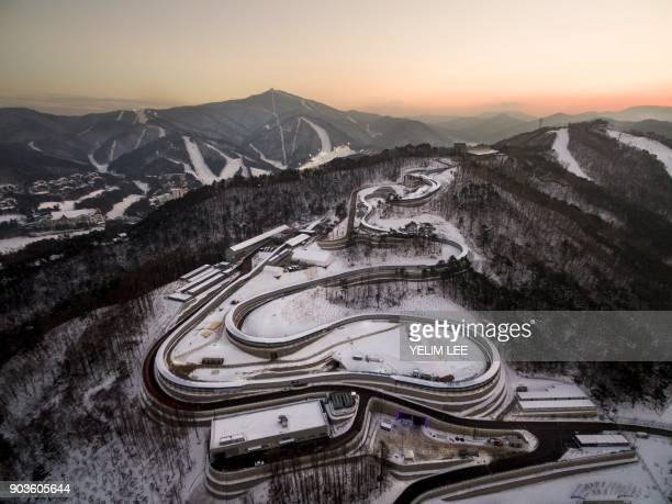 This picture taken on December 28 2017 in Pyeongchang shows the Olympic Sliding Centre a venue for the 2018 Pyeongchang Winter Olympics Thousands of...