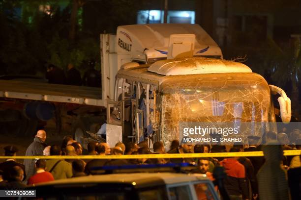 This picture taken on December 28 2018 shows officials visiting the scene of an attack on a tourist bus in Giza province south of the Egyptian...