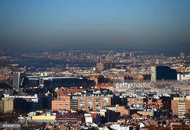 This picture taken on December 29 2016 shows pollution covering the sky above Madrid Madrid's city hall announced yesterday it had ordered half of...