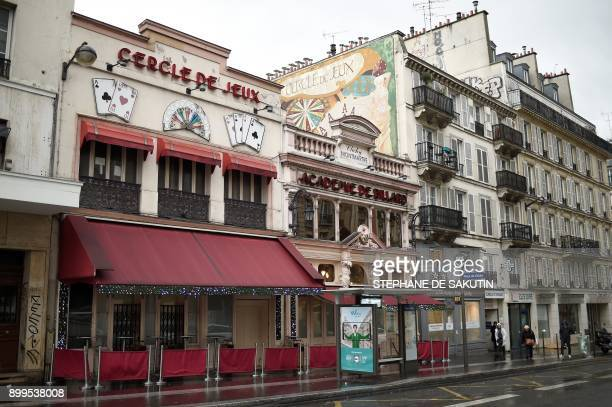 This picture taken on December 29 2017 shows the facades of the 'Cercle de Jeux' and 'Academie de billard' gambling clubs in Paris From January 2018...