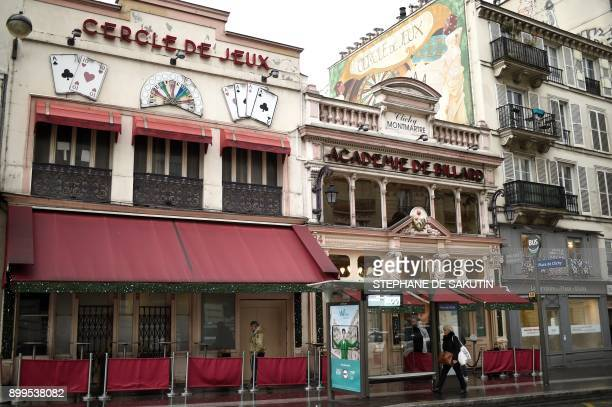 This picture taken on December 29 2017 shows the facades of the 'Cercle de Jeux' and the 'Academie de billard' gambling clubs in Paris From January...