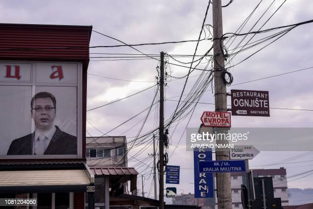 This picture taken on December 29 2018 shows the portrait of the Serbian President displayed at the office of a Serbian political party in the town...
