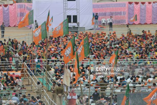 This picture taken on December 3 2017 shows Bharatiya Janata Party flags seen around the BJP supporters participating in a rally addressed by Indian...