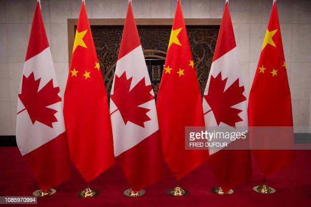 This picture taken on December 5 shows Canadian and Chinese flags taken prior to a meeting with Canada's Prime Minister Justin Trudeau and China's...