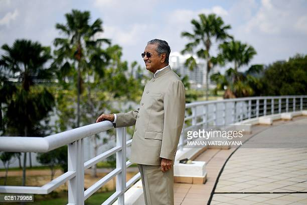 This picture taken on December 6 2016 shows Malaysia's former prime minister Mahathir Mohamad posing after an interview with AFP at his office in...