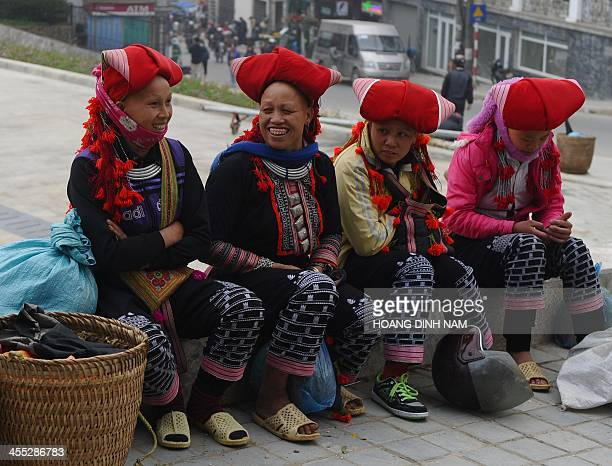 This picture taken on December 7 2013 shows a Dao ethnic women chatting on the church square in downtown of the popular tourist district of Sapa...