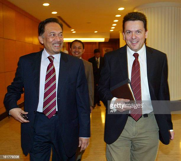 This picture taken on December 8 2010 shows Malaysia's opposition leader Anwar Ibrahim walking with Nick Xenophon an outspoken independent Senator of...