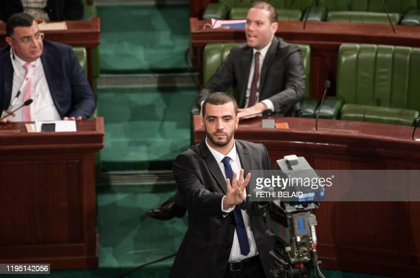 This picture taken on December 8, 2019 during a session of Tunisia's Assembly of Representatives shows Islamist Tunisian lawmaker Rached Khiari...