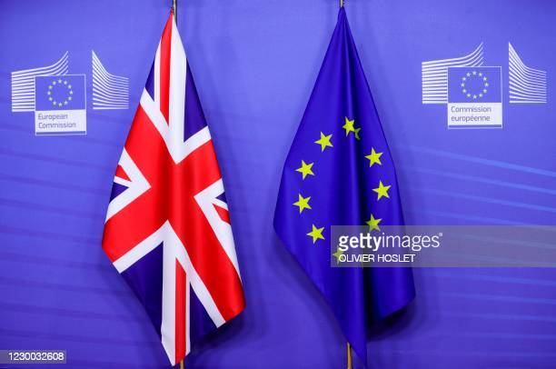 This picture taken on December 9 shows flags of the Union Jack and the EU ahead of Britain's Prime Minister's meeting on post Brexit trade deal with...