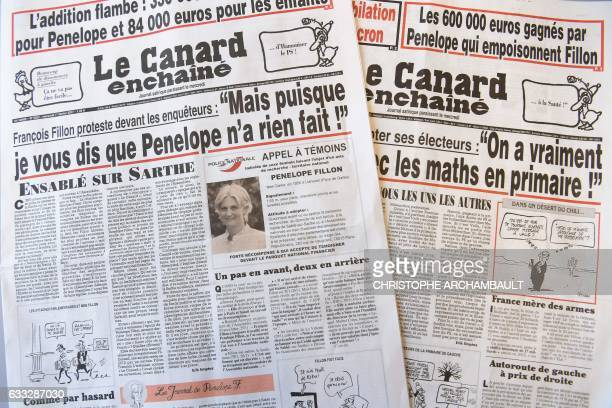 This picture taken on February 1 2017 in Paris shows the front pages dated January 25 2017 and February 1 2017 of French satirical newspaper 'Le...