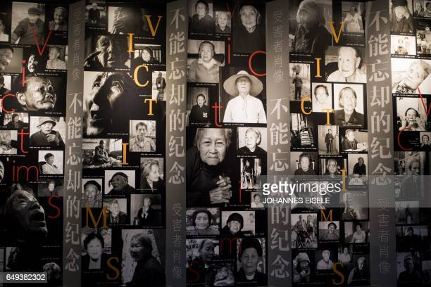 This picture taken on February 1 2017 shows pictures of socalled comfort women on a wall in a museum in Shanghai Mainstream historians agree that...