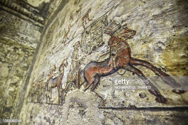 This picture taken on February 1, 2019 shows an inscribed painting of an Egyptian chariot with hieroglyphics, at the tomb of the ancient Egyptian...