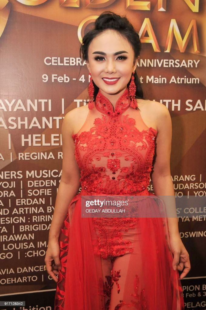 This picture taken on february 11 2018 shows indonesian singer yuni this picture taken on february 11 2018 shows indonesian singer yuni shara posing during a reheart Choice Image