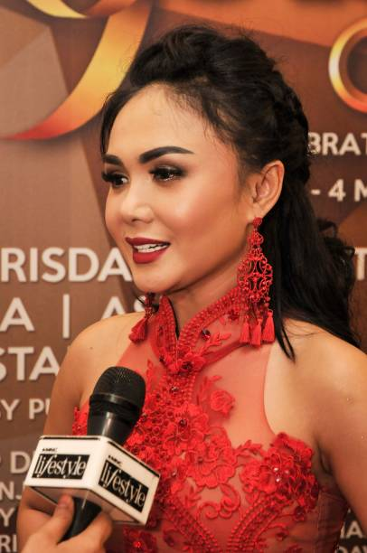 This picture taken on february 11 2018 shows indonesian singer yuni this picture taken on february 11 2018 shows indonesian singer yuni shara speaking during a reheart Image collections